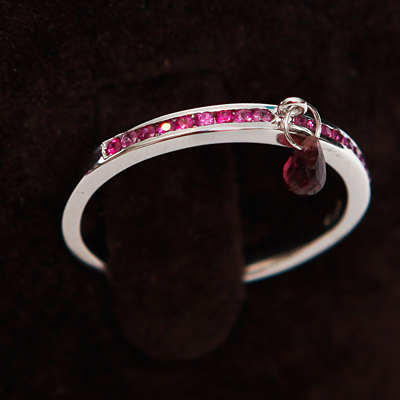 Gold Half Diamond Eternity Thumb Ring with a Pink Tourmaline 18ct gold with 0.25ct of diamond